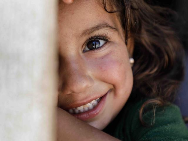 A young girl smiling in the camera
