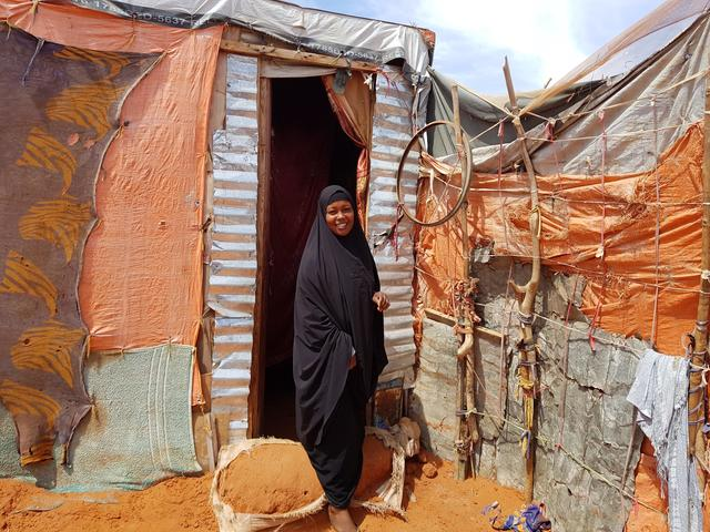Beeso stands outside her home in Harhaar camp