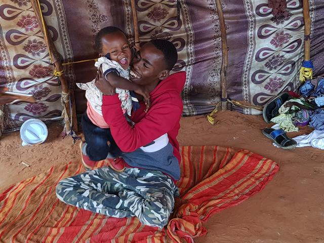 Beeso's husband Abdullahi plays with his six-month-old daughter Hibo