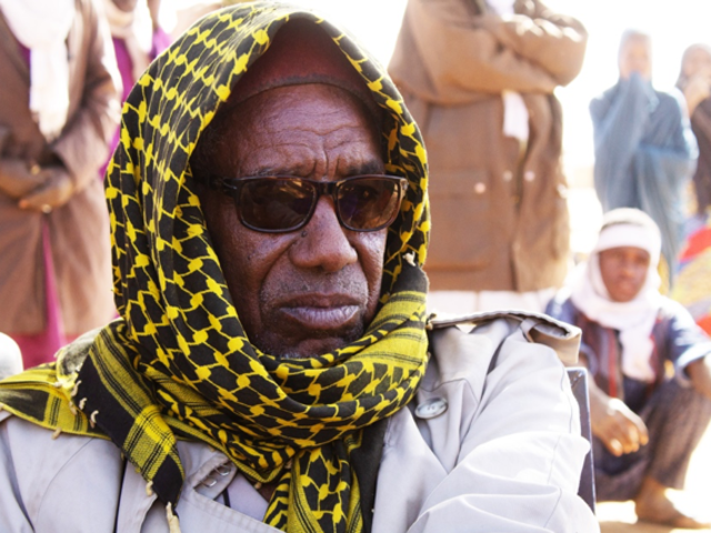 Man with headscarf and sunglasses