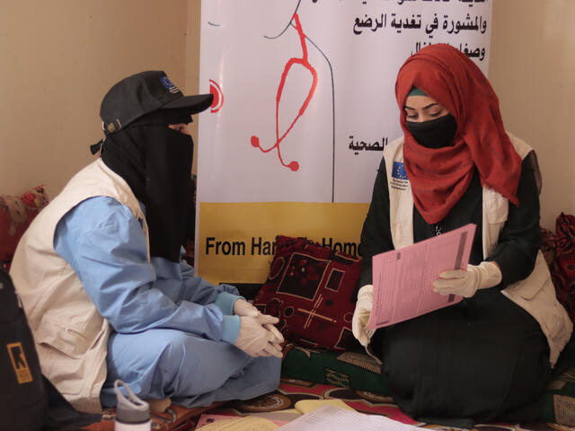 Dr. Bushra with an IRC healthworker during one of their field visits