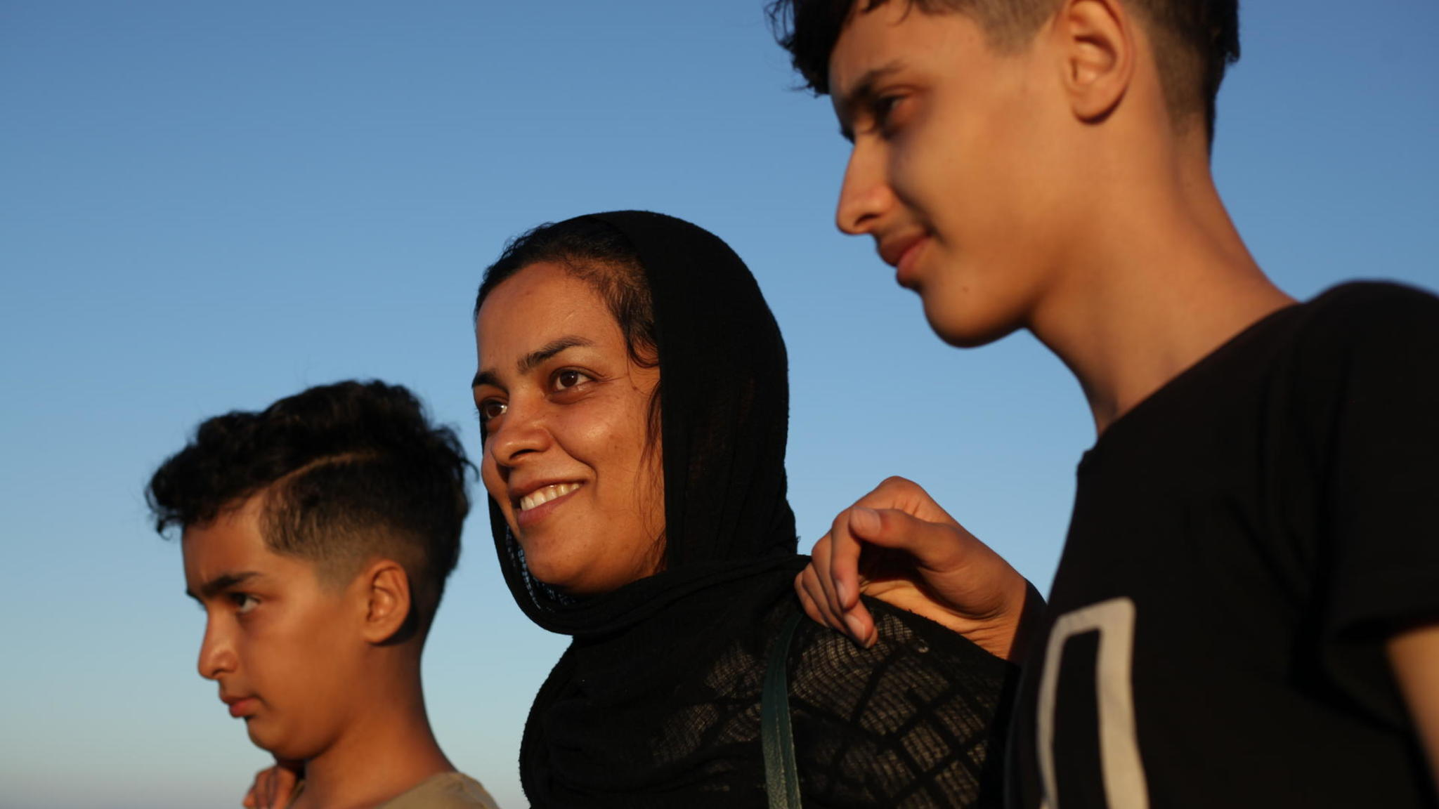 Wahida and her sons in Lesvos.