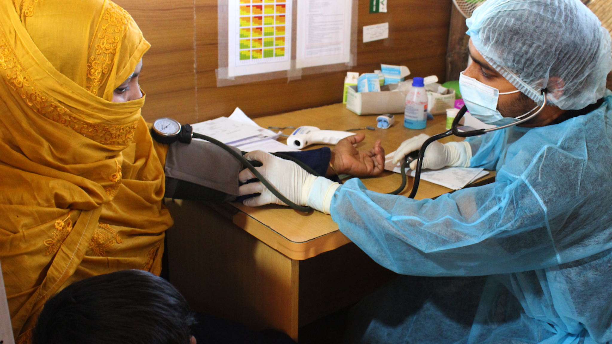 A woman getting her temperature measured in the IRC clinic in Bangladesh.