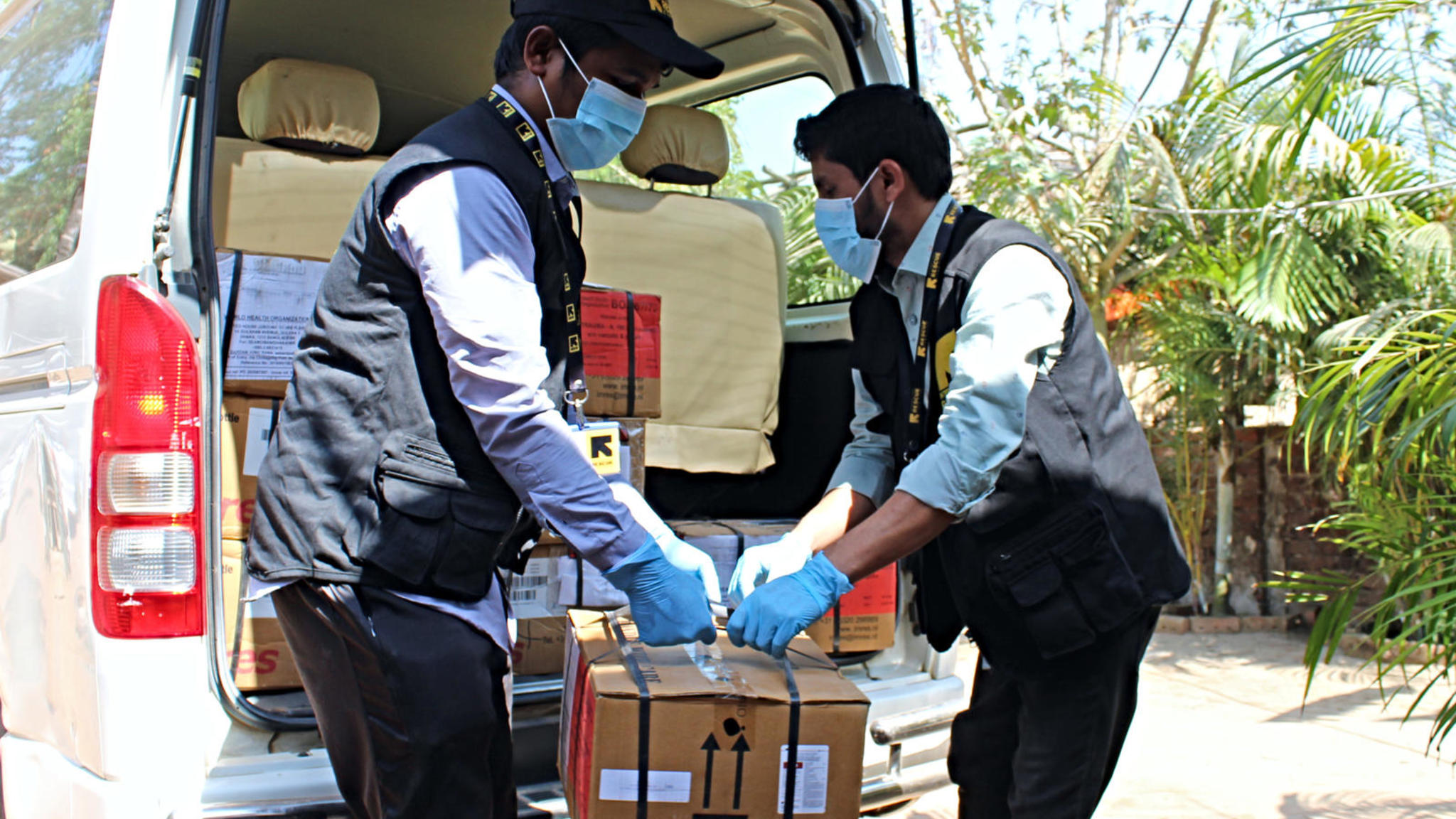 IRC staff unloads equipment as the IRC primary health care center in Cox's Bazar ramped up preparations for confronting the coronavirus pandemic.