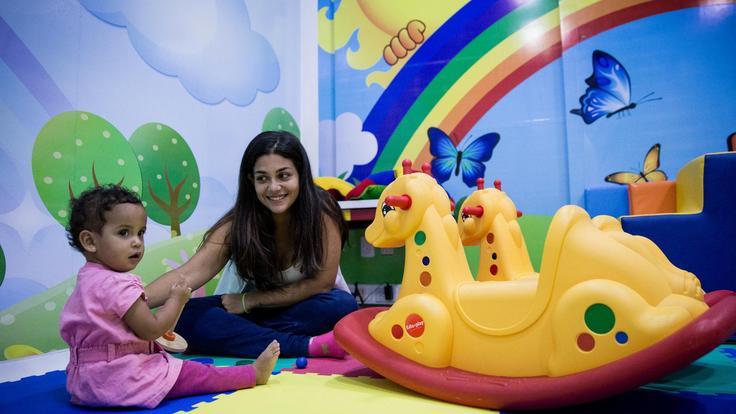 Young child and woman in a children room